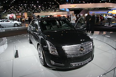 cadillac cts-v(0.0), supercar(0.0), automobile(1.0), exhibition(1.0), executive car(1.0), cadillac(1.0), vehicle(1.0), cadillac xts(1.0), automotive design(1.0), auto show(1.0), cadillac cts(1.0), sedan(1.0), land vehicle(1.0), luxury vehicle(1.0),
