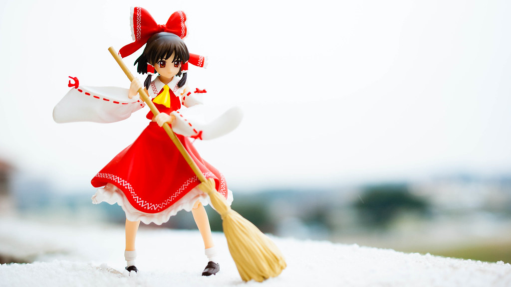Reimu sweeping up!