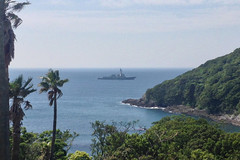 USS Mustin (DDG 89) sits at anchor off the coast of Shimoda, May 16. (U.S. Navy/MC1 Trevor Welsh)
