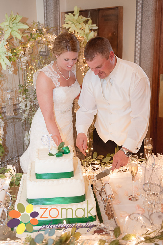 bride and groom cut their wedding cake at front street station in butte mt