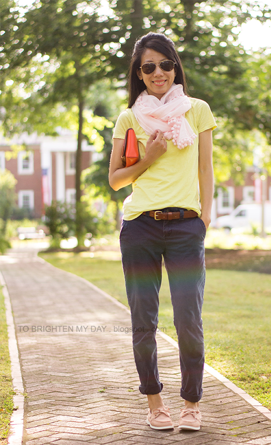 pink scarf, yellow tee, orange clutch