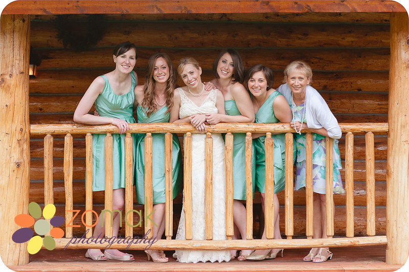 The bride and her girls pose outside the lodge where they're getting ready in Seeley Lake