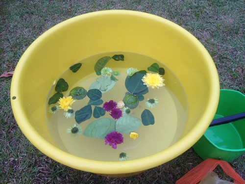 Singapore Biennale 2013. Preparing the bath water for Mandi Bunga, Courtesy of Helmie Kremers.