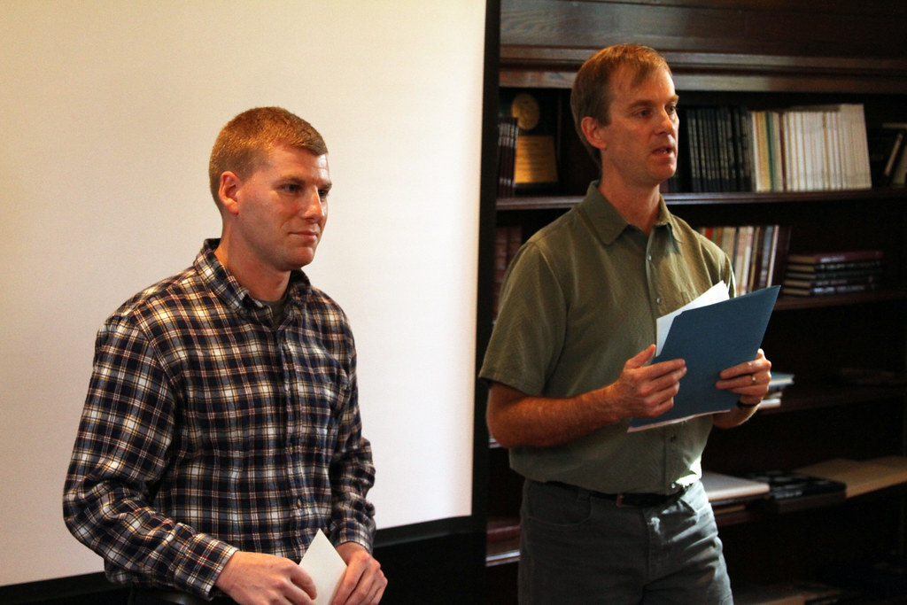 Kyle Lanzit '14 (left) receives a Presidential Green Grant for his proposal to make Union more bike-friendly.