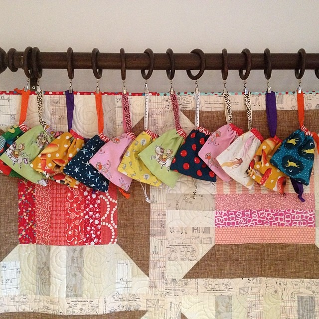 12 little bags ready to be stuffed with sweets and chocolate for @sewjustinesew's charity craft fair