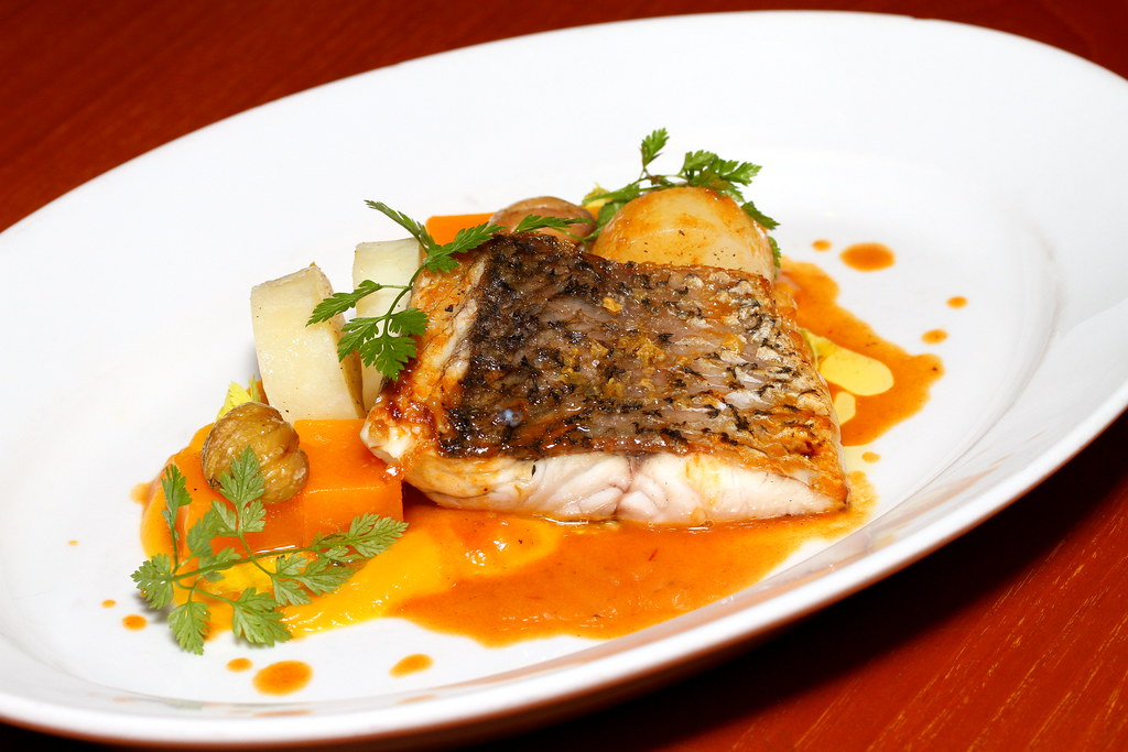Grand Hyatt Singapore's Mezza9's Wood Fired Barramundi with Pumpkin, Potatoes, Chestnut and Crustacean Jus