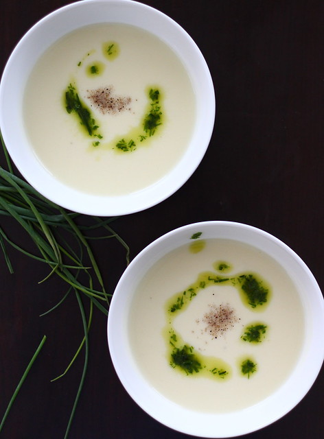 Creamy cauliflower soup with chive oil and espresso salt