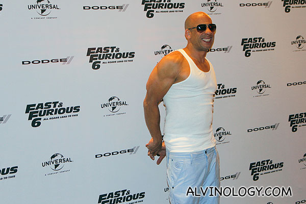 Vin Diesel flexing his muscles