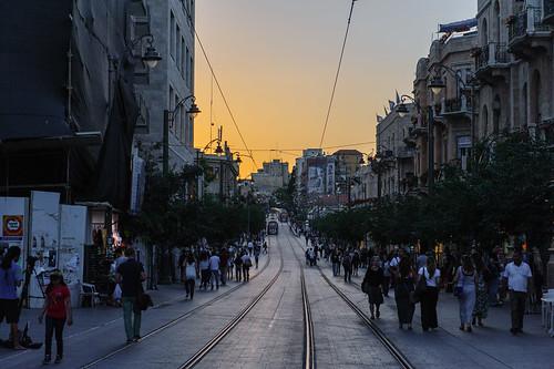 road street city people evening dusk jerusalem tracks tram