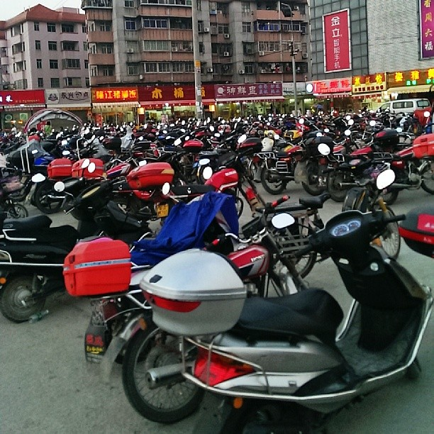 A sea of #scooters and #mopeds parked outside the local metro subway in #Guangzhou #China