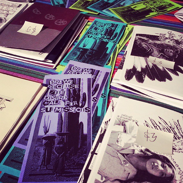Scenes from #RaceRiotTour: Brown Recluse Zine Distro tabling at @ucla Powell Library #zines #poczines