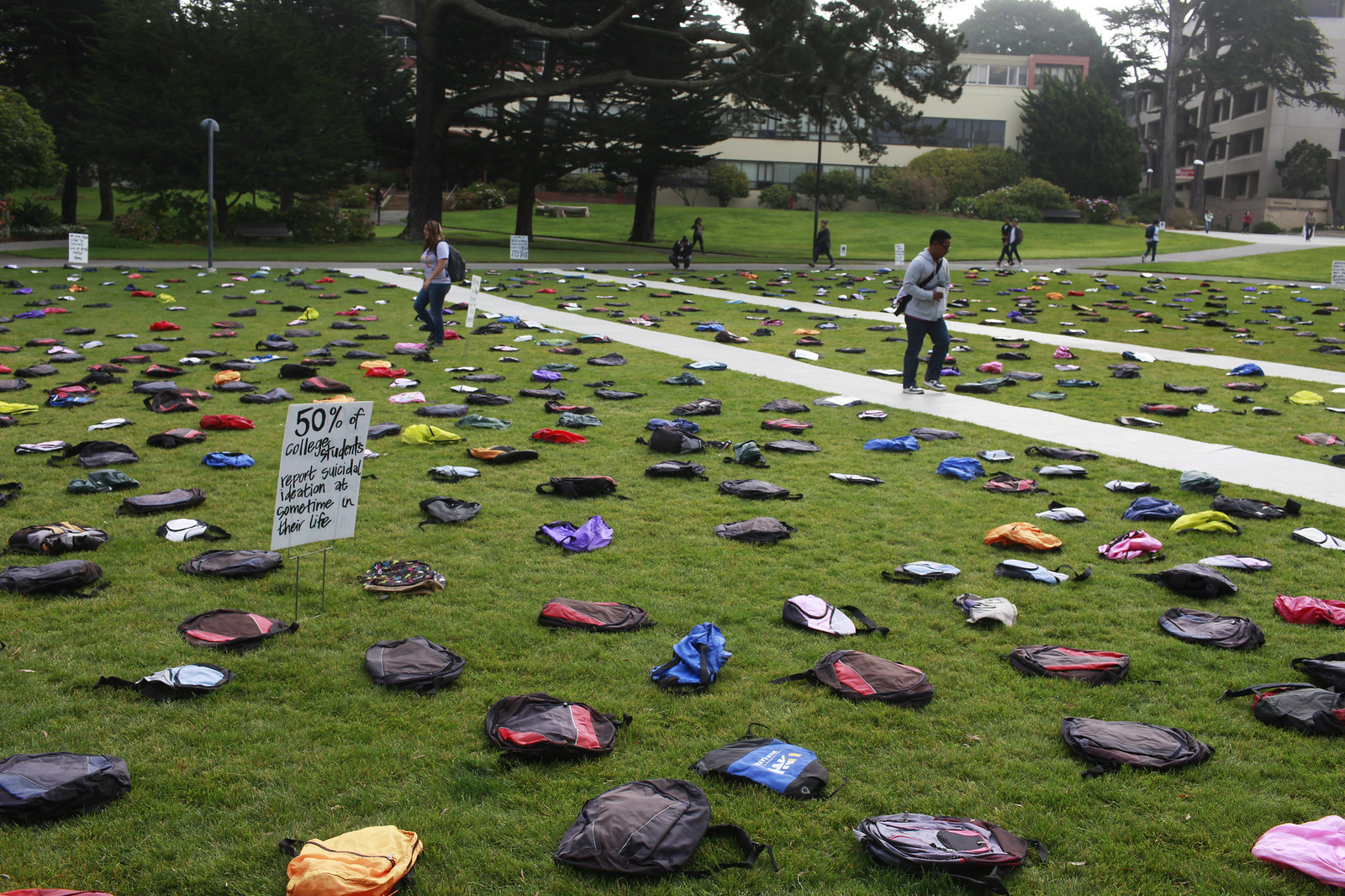 The lawn in the Quad is filled with 1100 backpacks to represent the number of college students who committed suicide in 2012, during the suicide prevention event organized by Send Silence Packing, an exhibit which travels to California college campuses during suicide prevention month. Photo by Mike Hendrickson / Xpress