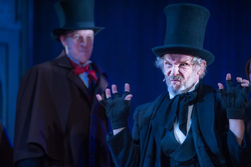 Anthony Bowers as Fred and Christopher Fairbank as Scrooge. Photo © Tommy ga Ken Wan