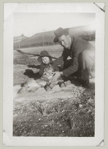Man, child and dog