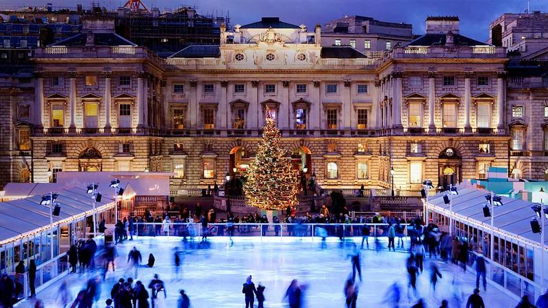 Twilight ice skating at Somerset House, London (© Fernando ManosoGallery Stock)