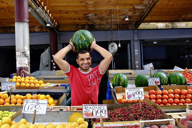A friendly (and cute) fruit seller at Athens Central Market