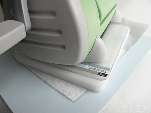 use the weight of a die cutting machine to flatten buckled painted paper