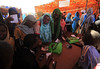 A voucher holds a cash value of 32 Sudanese pounds (approximately US$5.8).  The number of coupons corresponds to the number of members registered on each family's ration card.    ‾‾‾‾‾‾‾‾‾‾‾‾‾‾‾‾‾‾‾‾‾‾‾‾‾‾ Chaque bon vaut 32 livres soudanaises (environ 5,8 USD). Le nombre de coupons correspond au nombre de personnes enregistrées sur la carte d'alimentation de chaque famille.   Photo credit: WFP/Mohamed Nureldin Abdallah