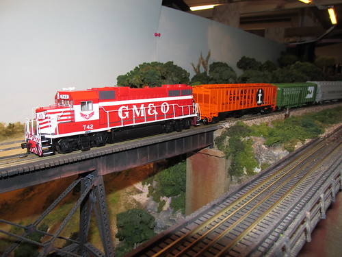 A 1970's era Illinois Central Gulf train with a former G,M & O locomotive up front enters the tall steel trestle.  The Oak Park Society of Model Engineers,H.O Scale Model Railroad Club.  Oak Park Illinois.  October 2013, by Eddie from Chicago