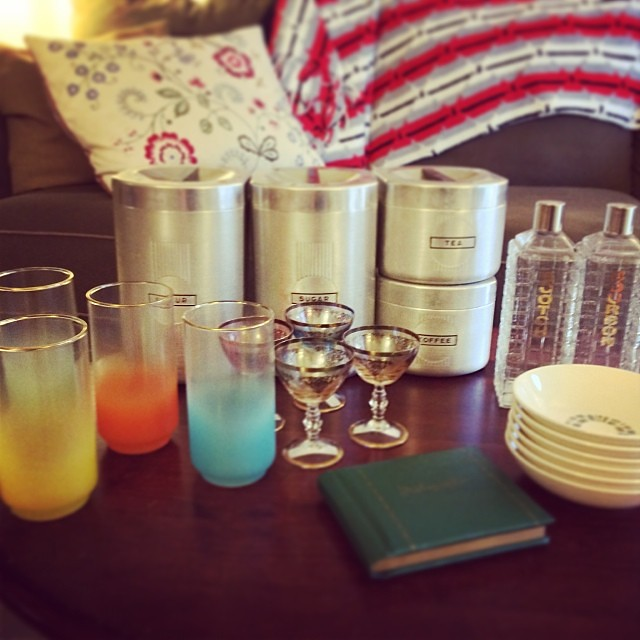 Recent vintage thrift finds:  mid-century canisters, colored glassware, colored cordial glassware, labeled liquor decanters, atomic patterned bowls, autograph book. Coming soon to the shop. #vintage #vintagesoup