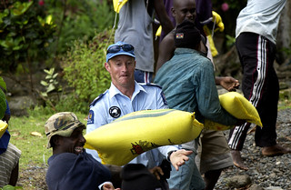 New Zealand police assisting with delivery of humanitarian supplies from AusAID. Solomon Islands 2003. Photo: © Gary Ramage, Australian Defence