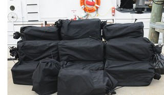 Twenty bales of cocaine are shown at Coast Guard Sector St. Petersburg, Fla., Thursday, Nov. 7, 2013. The crew of the Coast Guard Cutter Sitkinak, homeported in Miami, transported the $19 million estimated wholesale value of contraband to the sector after it was seized in the Caribbean Sea in support of Operation Martillo. U.S. Coast Guard photo by Petty Officer 1st Class Crystalynn A. Kneen