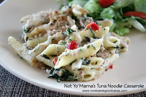 Tuna Noodle Casserole on white plate with green salad.
