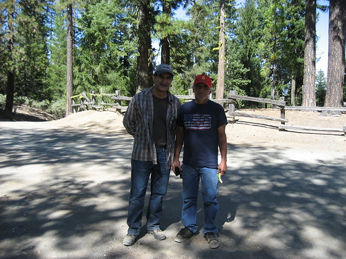 Eduardo Olmedo (left), Grindstone District Ranger, and Kenneth Wright, Round Valley Indian Tribes President, enjoy the shade after a morning of hiking the Nome Cult trail on the Mendocino National Forest. (U.S. Forest Service/Denise Adamic)
