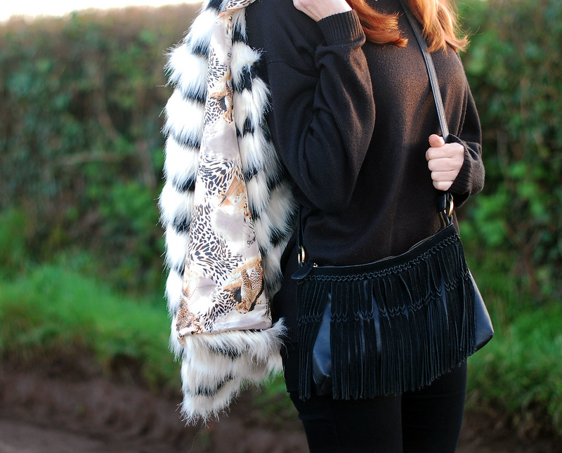 Black & white striped fur coat, black sweater