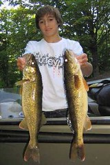 Nate Sabec shows off a pair of Turtle-Flambeau Flowage walleyes