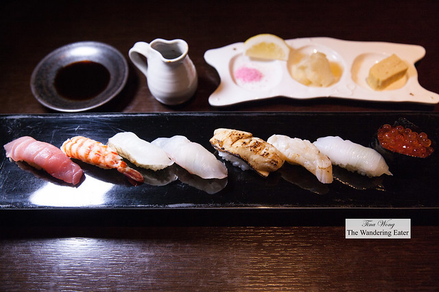 8-piece sushi platter made with local Okinawa fish - (left to right) Lean tuna (Akami Minami-maguro), prawn, Makubu (spelling?), Madai (Red sea bream), Torched conger eel, scallop, squid, ikura (salmon roe) maki