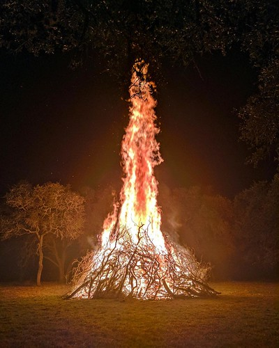 Our Winter Solstice bonfire: a massive tower of flames burning 30-40 feet high. The tangle of mossy oak branches stood taller than me. The incredible heat and blaze was so intense after beginning our Solstice ritual in the cold and darkness - to better ho