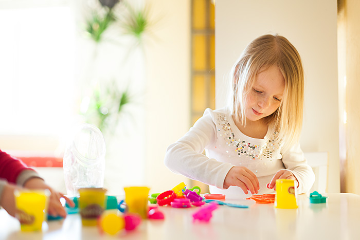 A Child playing with Play-Doh