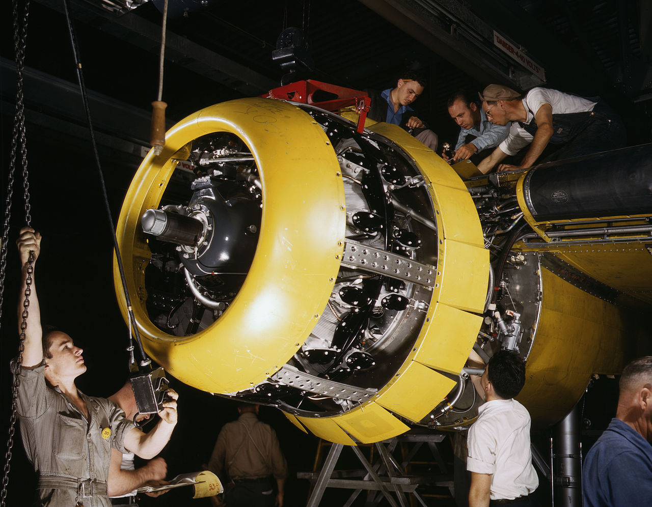 "Mounting of a Wright R-2600 Cyclone engine on a North American B-25 Mitchell bomber, at North American Aviation, Inglewood, California (USA). The Wright R-2600 was the standard engine on the B-25.[1] Original description: ""Mounting motor [on a] Fairfax B-25 bomber, at North American Aviation, Inc., plant in [Inglewood], Calif."""