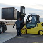 Waste management operators use a forklift to load the first munitions from the 155mm campaign processed at the Pueblo Chemical Agent-Destruction Pilot Plant. A Munitions Treatment Unit Storage Bin is lifted on to a trailer in preparation for transport to a recycling center.