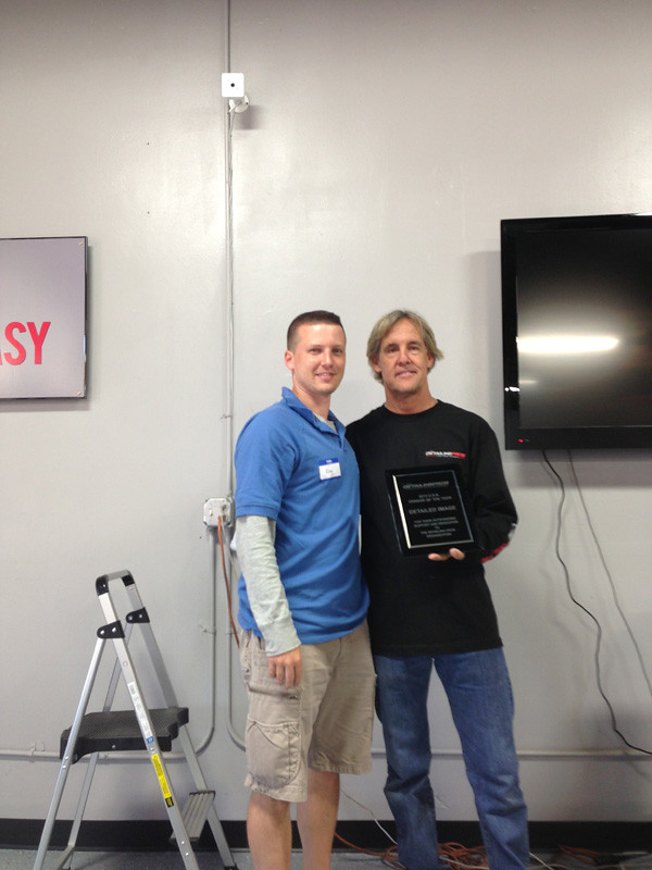 Greg accepts award for Vendor of the Year 2013 from Mel Craig