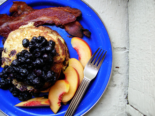 oatmeal lemon ricotta pancakes with blueberry compote, peaches, and bacon