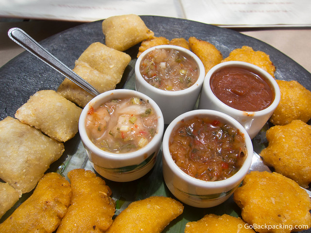 Three types of Colombian empanadas, with four types of fresh salsa