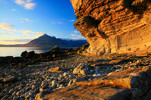 sunset sea sky cliff sun mountains skye yellow rock clouds islands scotland highlands glow isleofskye rocky boulders honey shore cuillins hebrides cuillin elgol