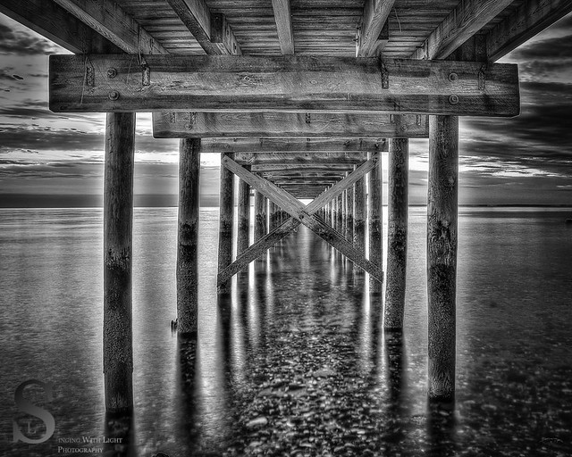 Under the pier BW