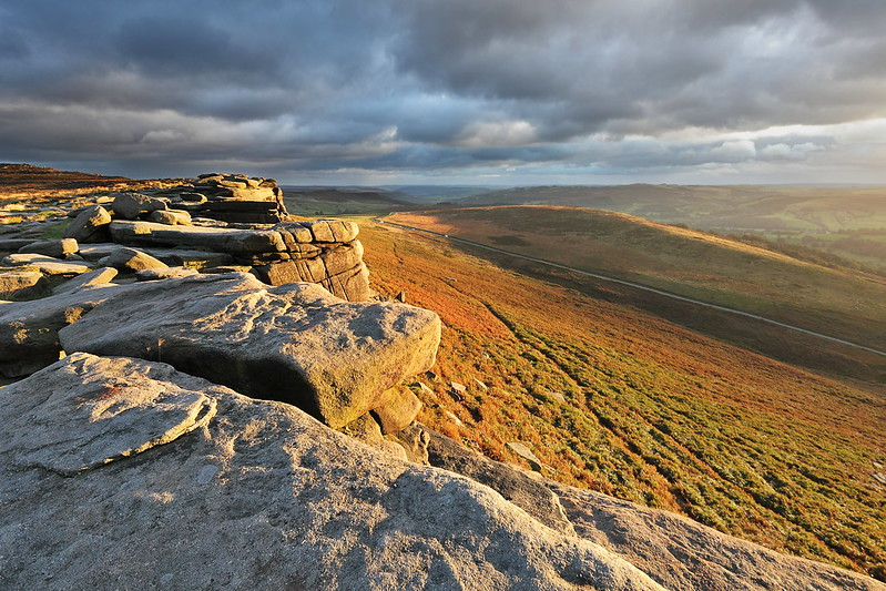 Golden light in this landscape photo of Stanage Edge on the outskirts of Sheffield in the Derbyshire Peak District.