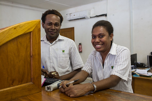 Bank tellers at the National Bank of Vanuatu on Malekula island waits to serve a customer.