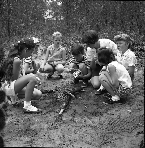 Girl Scouts learning to build a fire at Lake Andrews near Tallahassee, Florida