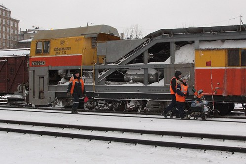 Track inspection crew pass the stabled snow clearing train