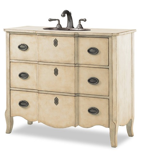 Luxury  color of this painted wood piece it es in antique linen and antique chestnut Two of the drawers create storage in this lovely bathroom vanity