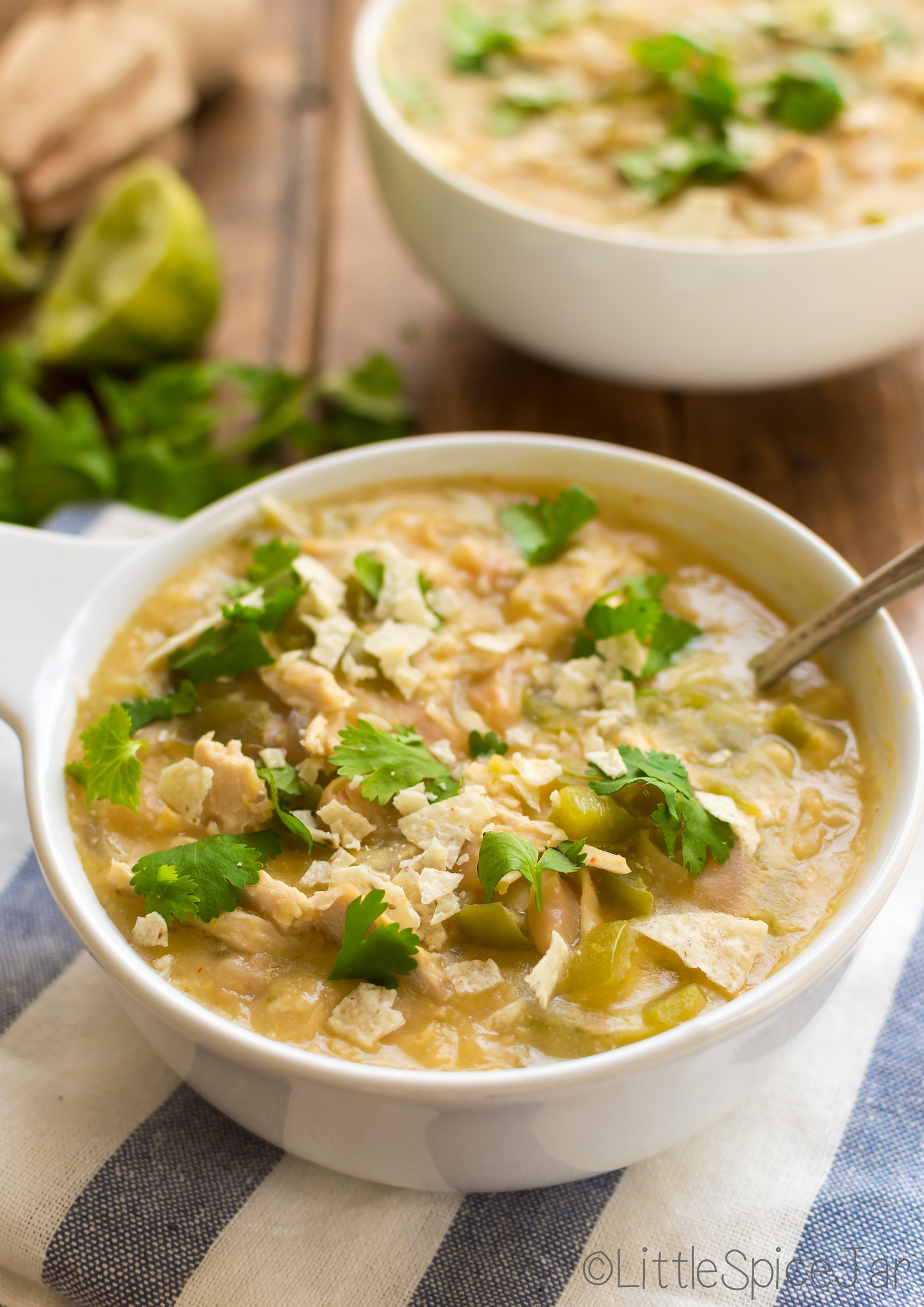 bowls of white chicken chili with spoon