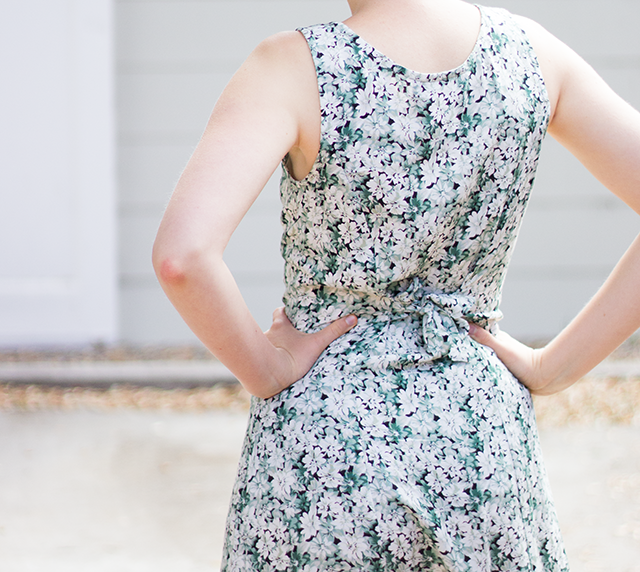 summery green-and-white floral dress with defined waist