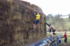 Simon climbing the Hay Bails Image