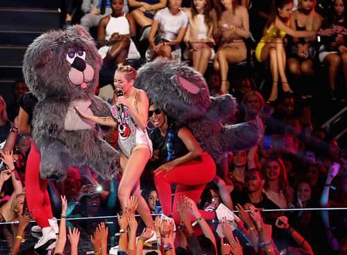 Miley Cyrus dancing with a teddy bear
