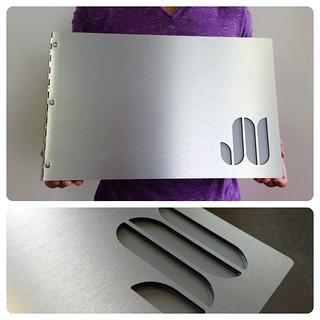 Custom brushed silver graphic design portfolio book with cut-out treatment